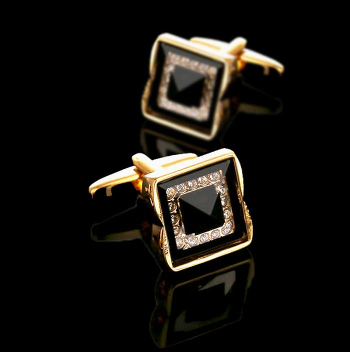 Mens Swank Black And Gold Cufflinks Set from Gentlemansguru.com